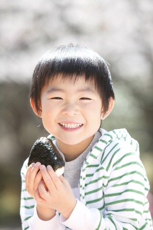 Boy eating rice balls