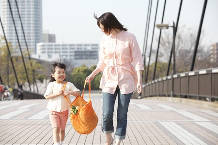 overpass: Girl with eco bag with his mother