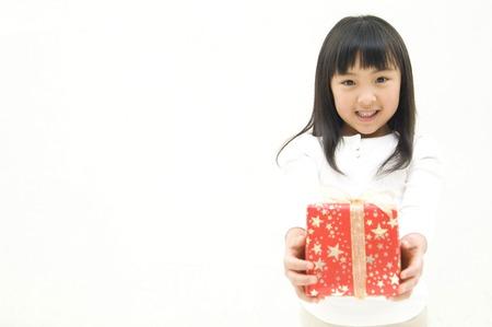 classwork: Girl to pass the gift Stock Photo