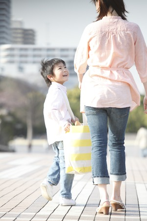 Boy with eco bag with his mother