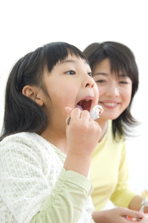 nuclear family: Mothers feed strawberries to daughter