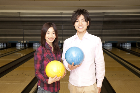 play date: Men and women with a bowling ball Stock Photo
