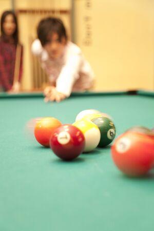play date: Men hit the break shot