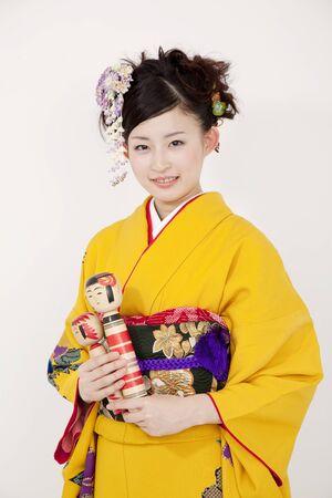 Kimono women with Kokeshi
