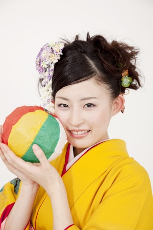 early 20s: Kimono woman with a paper balloon
