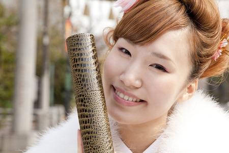 early 20s: Women kimono figure with a diploma