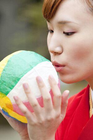 inflate: Women kimono figure inflate the paper balloon Stock Photo