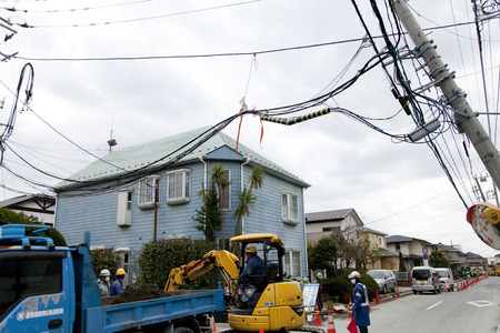 outage power: Telephone poles leaned on liquefaction Editorial