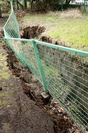 deformation: Fence that was depressed by liquefaction