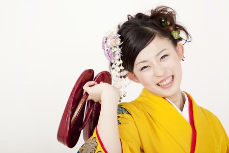 early 20s: Kimono woman Holding sandals