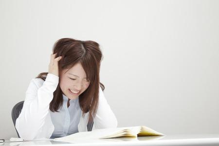 holding on head: Woman holding head