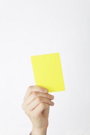 yellow card: Hand to issue a yellow card