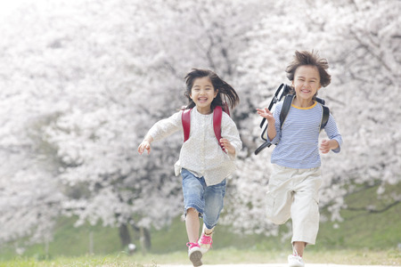 Elementary school students running the cherry trees