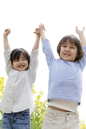 hurray: Children to Banzai hold hands Stock Photo
