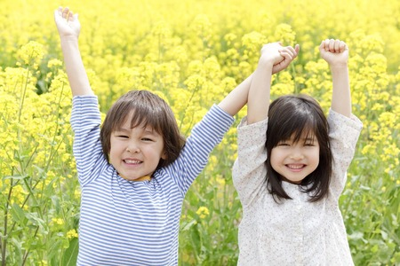 Children to Banzai hold hands Stock Photo