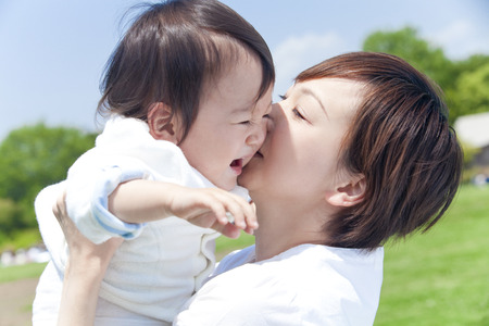 Mother to kiss and lift up the boy