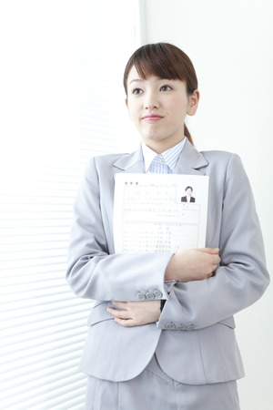 Woman waiting for a interview with a resume