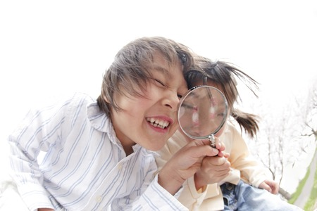 Children peek at the magnifying glass