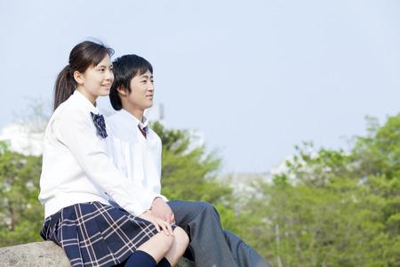 High school couple stare far Stock Photo