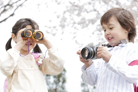 associates: Girl except for the boys and binoculars with a camera