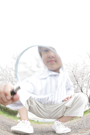 peek: Boy peek at the magnifying glass Stock Photo