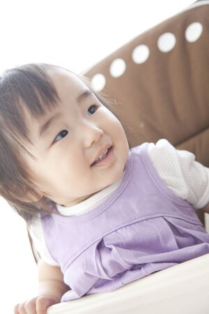 baby chair: Girl smiling sitting in baby chair