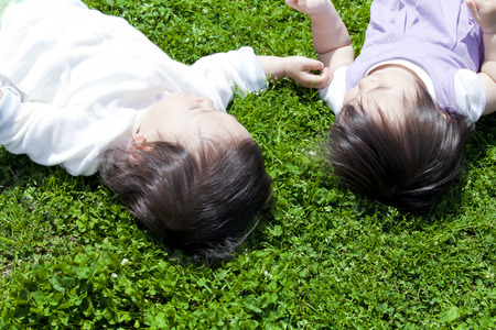 lie: Children lie down in the park Stock Photo