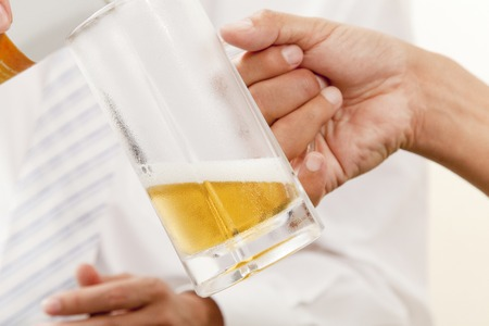 pouring beer: Hand of businessman get pouring beer