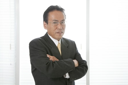 middleaged: Middle-aged businessman to his arms folded Stock Photo