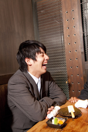 farewell party: Smile businessman in tavern Stock Photo