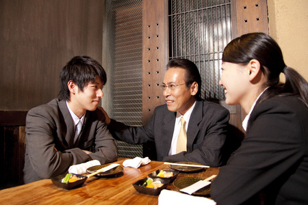 farewell party: and chatting to businessman