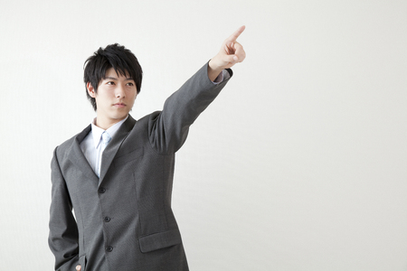 Businessman pointing the finger