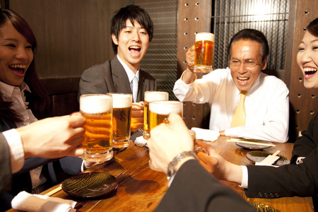 farewell party: Businessman for a toast at the tavern