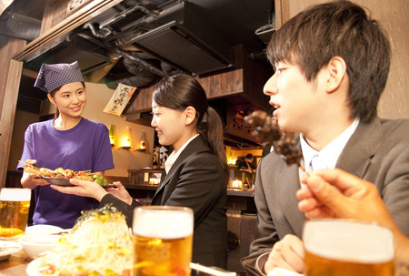 Tavern employees who carry the food and businessman Stock Photo