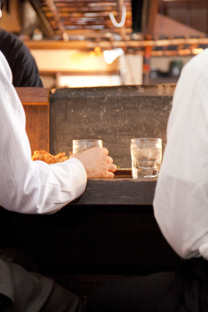 farewell party: Hand of businessman drinking shochu Stock Photo