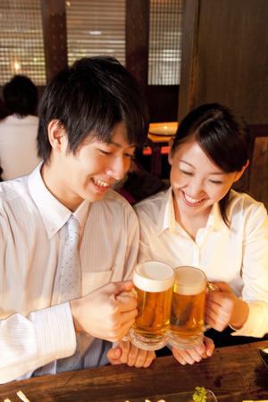 farewell party: Businessman for a toast with beer