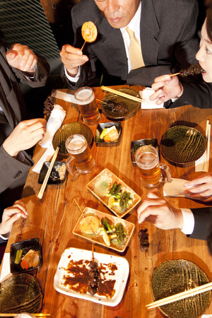 Businessman to be eating and drinking at the tavern Stock Photo