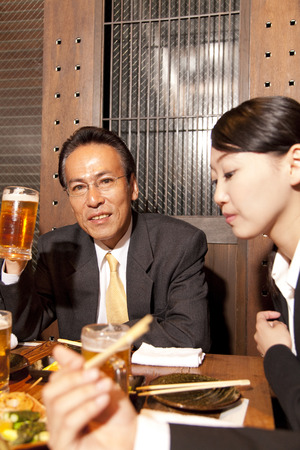 farewell party: Businessman to be eating and drinking at the tavern Stock Photo