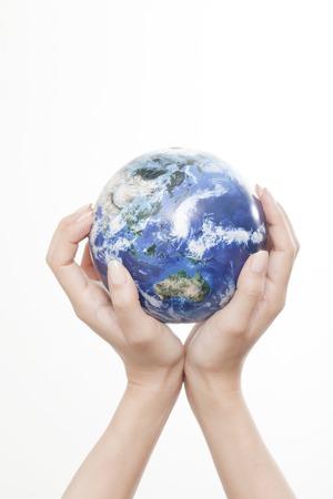 Hand of woman with globe 版權商用圖片