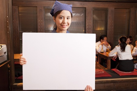 farewell party: Tavern clerk smiling with a message board Stock Photo