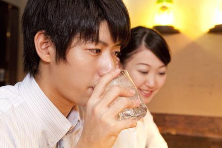 farewell party: Businessman drinking shochu