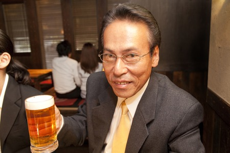farewell party: Businessman smiling a beer in one hand