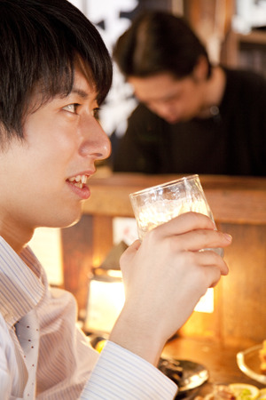 farewell party: Businessman drinking shochu at the counter