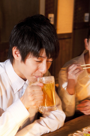 farewell party: Businessman drinking beer Stock Photo