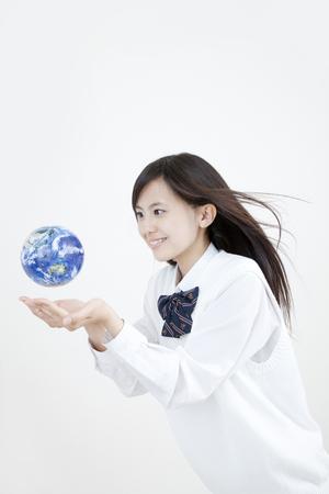 holding globe: High school girl holding globe