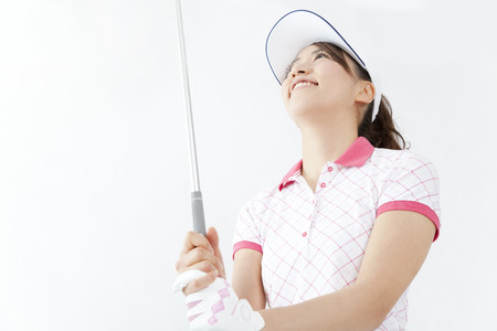 Women who hold a golf club