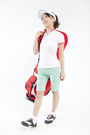 to be pleasant: Woman smiles in golf style