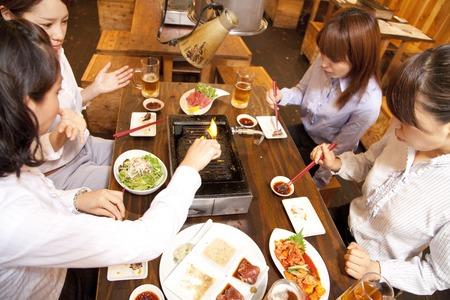 Women around the roast Stock Photo