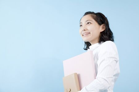 asian teenager: OL smile you have documents Stock Photo