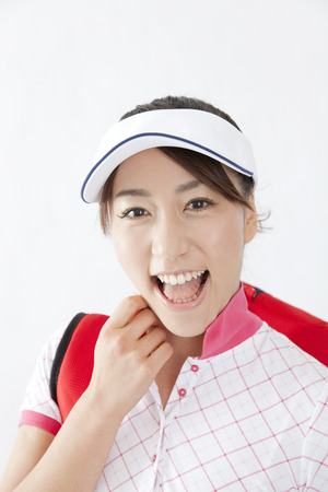 woman golf: Woman smiles in golf style